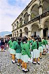 Guatemala, Antigua, Plaza Mayor, young girls wearing school uniform