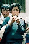 Peru, Pisac, child playing the flute