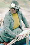 Peru, Cusco, Indian woman weaving llama wool