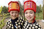 China, Yunnan, near Kunming, Yunnan Nationalities Village, young Jingpo women