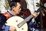 China, Yunnan, Dali, Bai man playing the shamisen