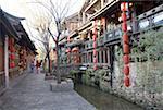 China, Yunnan, Lijiang, souvenir shops along a canal