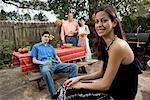 A Mexican-American family enjoying a backyard picnic