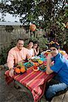 Mexican-American family enjoying a picnic in the backyard