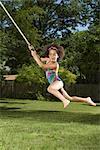 Girl Swinging on Rope