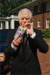 Man lighting cigar with money