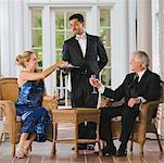 Butler serving wealthy couple