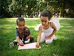 Children Coloring in Yard