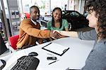 Couple With Car Saleswoman