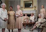 Senior and mature women at tea party, portrait