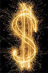 Dollarzeichen gezeichnet mit einer Wunderkerze