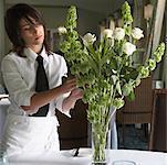 Waitress Arranging Flowers