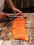 Person Slicing Fish