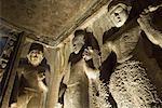 Low angle view of statues of Buddha in a cave, Ajanta, Maharashtra, India