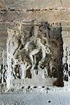 Statue of Hindu god in a cave, Ellora, Aurangabad, Maharashtra, India