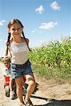Girl and Boy with Corn and Wagon