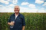 Farmer by Corn Field