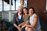 Couple with Grandchildren on Porch