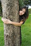 Portrait of Woman Hugging a Tree