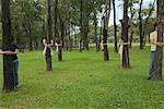 People in Park Hugging Trees