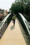 Rear view of a woman walking on a footbridge, Savannah, Georgia, USA