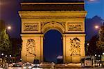 Triumphal arch lit up at night, Arc De Triomphe, Paris, France