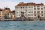Gondolas docked in front of a statue, Vittorio Emanuele II Statue, Riva Degli Schiavoni, Venice, Italy