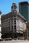Tourists in front of a building, Plaza De Mayo, Barrio De Monserrat, Buenos Aires, Argentina
