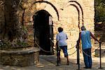 Tourists entering an old building Ephesus, Turkey