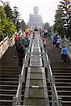 Low angle view of tourists visiting a monastery, Tian Tan Buddha, Po Lin Monastery, Ngong Ping, Lantau, Hong Kong, China