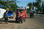 Passengers traveling in a jinrikisha, Luang Prabang, Laos