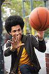 Portrait of Teenaged Boy With Basketball