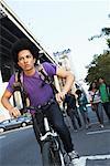 Teenaged Boy on Bicycle