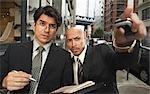 Les hommes d'affaires sur le trottoir, New York City, New York, USA