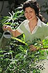 Woman watering plants in the garden