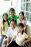 Family looking at camera and smiling