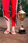 Woman Standing Beside Trophy