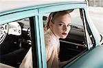 Woman in 1957 Dodge RegentCar