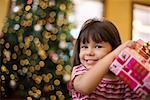 Smiling girl with Christmas gift