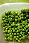 Lots of mangetout peas in bowl of water