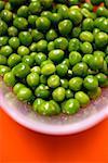 Lots of peas in bowl of water