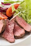 Beef steak, sliced, with salad