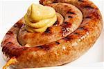 Aufgerollter Bratwurst mit Senf-blob