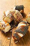 Assorted pretzel rolls on wooden background