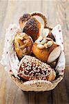 Assorted pretzel rolls (or lye rolls) in bread basket