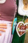 Two women with Lebkuchen hearts (Oktoberfest, Munich)