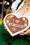 Woman with Lebkuchen heart (Oktoberfest, Munich)