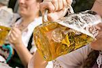 Woman drinking a litre of light beer (Oktoberfest, Munich)