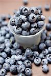 Blueberries with plastic beaker