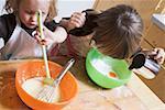 Two children baking